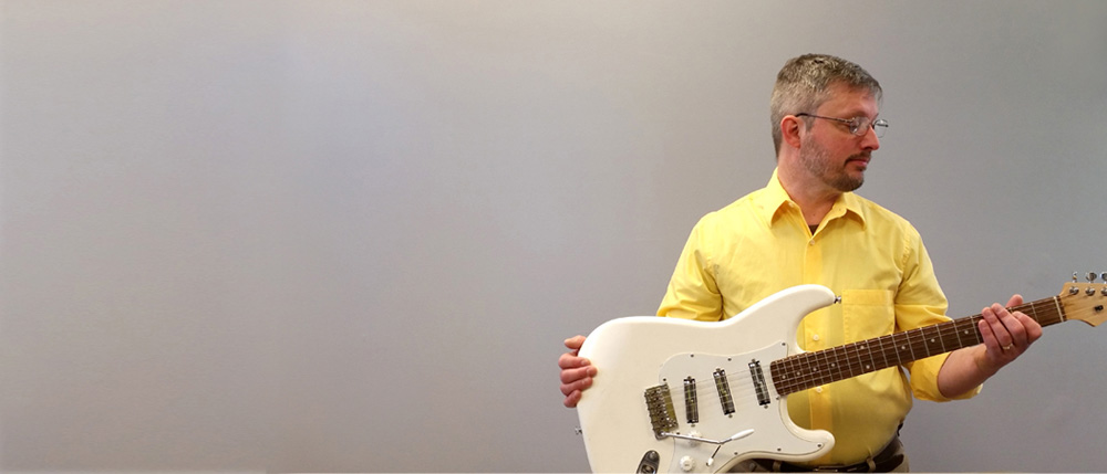 Second - Dave Dick with electric guitar